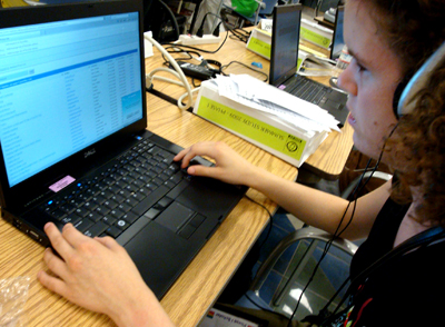 Picture of student using laptop with accessible technology.