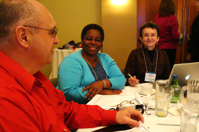 Photo of three faculty members collaborating at a capacity-building institute.