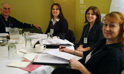 Image of four faculty members sitting at a table.