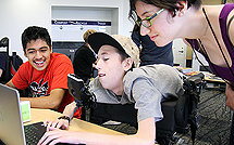 Image of students working together on a project