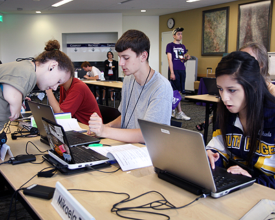 Image of students working in a computer lab on their laptops
