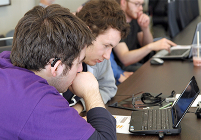 Two deaf students learning to code.