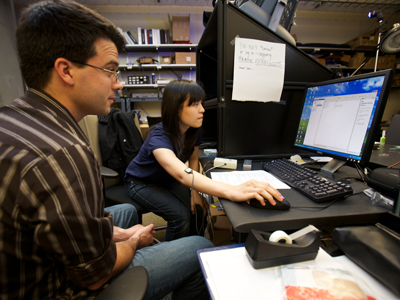 Image of two students working together on a computer