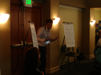Photo of a CBI participant given a presentation summary.