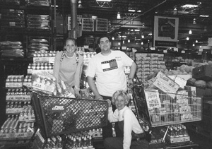 Photo of volunteer Katie, DO-IT Ambassador David, and DO-IT director Sheryl at Costco shopping