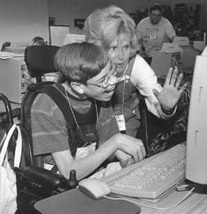 Photo of DO-IT director Sheryl and DO-IT Scholar Nick at a computer