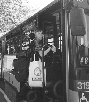 Photo of DO-IT Scholar Nick getting on a Metro bus.