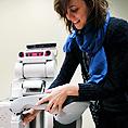Image of an instructor demonstrating robotics