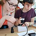 Image of two students working on a science lab