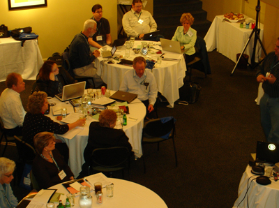 Photo of several Capacity Building Institute working groups sitting at round tables
