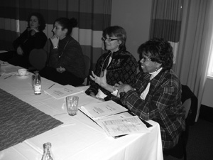 Photo of CBI participants talking while sitting at a large conference table