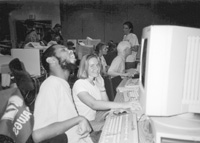 Photo of of James and Cheri in the computer lab.