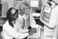 Image of DO-IT Director Sheryl working with a Scholar on a computer.