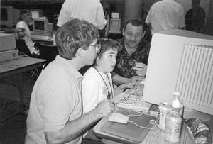 Photo of Bill, Kristin, and interpreter in the computer lab.