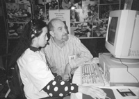 Photo of Priscilla and instructor in the computer lab