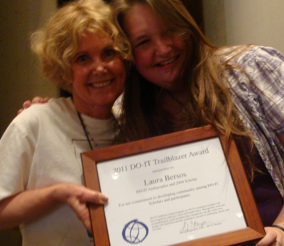 Photo of DO-IT director Sheryl and Laura smiling with the Trailblazer Award plaque.