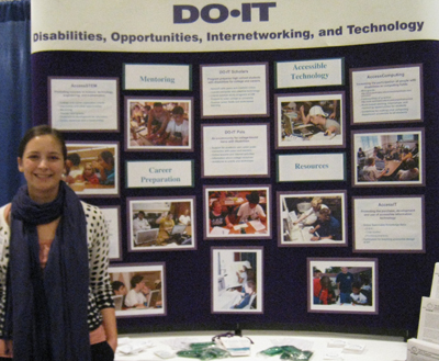 Photo of DO-IT staff member Brianna standing beside the DO-IT Display Booth.
