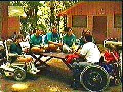 Photo of Easter Seals Camp Harmon campers seated at picnic table