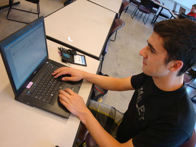 Student working on a laptop.