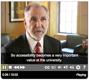 Image of man talking about accessibility on a video.