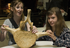 Photo of two DO-IT Scholars with a fossil