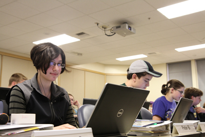 Photo of DO-IT Scholar using her laptop during a Summer Study lab session.