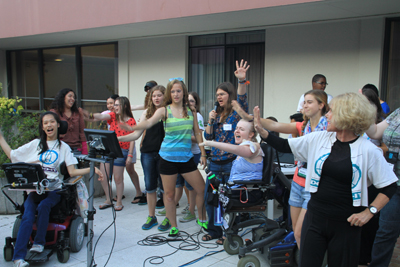 Photo of DO-IT Scholars, Ambassadors, and staff all sing Sheryl Burgstahler's favorite karaoke song, 'Stop! In the Name of Love' during ice cream and karaoke night