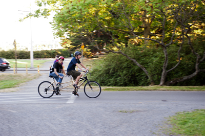 Photo of Phase I DO-IT Scholars Michael and Ryan ride a tandem bicycle on the Burke Gilman trail during Summer Study 2013