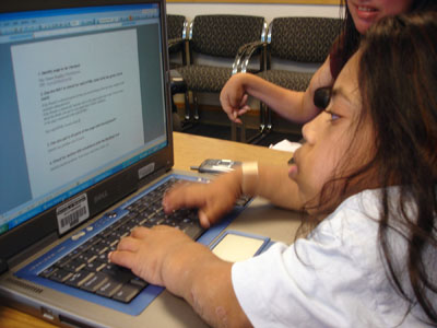 A student accesses the internet with a laptop.
