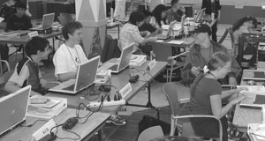 Image of students using laptops in a computer lab.