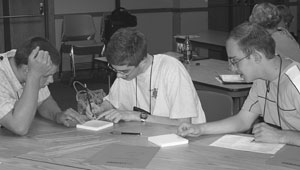 Image of a group of students collecting information during a science experiment