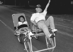 Image of DO-IT Scholar and Sheryl riding an accessible bicycle during Outdoors for All