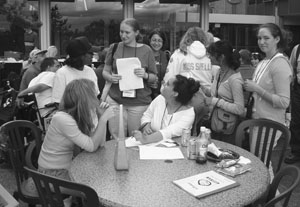Image of DO-IT Scholars eating lunch and socializing at a round table.