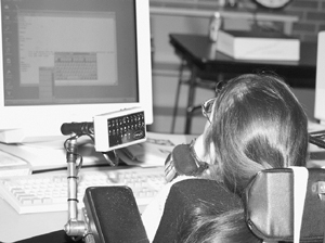 Photo of DO-IT Scholar uses computer for an activity in the DO-IT computer lab.