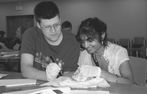 Image of two DO-IT Scholars dissecting a heart