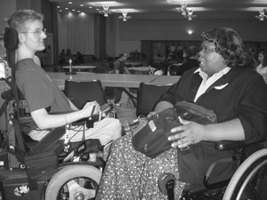 Image of a DO-IT Scholar in a wheelchair having a woman in a wheelchair.