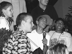 Image of DO-IT Scholars having fun participating in Karaoke.