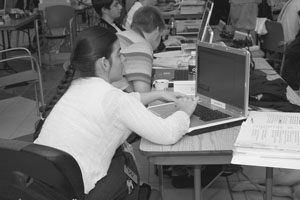 Image of Scholars working hard on their projects on their laptops