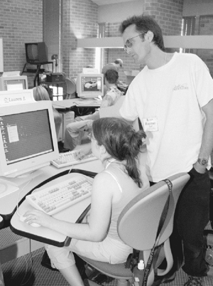 Photo of DO-IT staff member working with a Scholar at the computer.