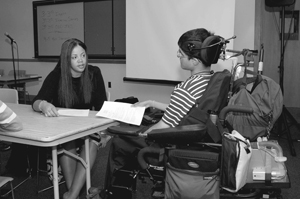 Photo of two DO-IT Scholars talk through an assignment in a classroom.