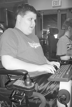 Photo of Student in wheelchair types on a keyboard.