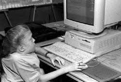 Photo of Amanda sitting at a computer