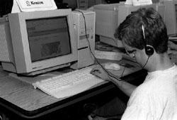 Photo of DO-IT Scholar Keaton browsing the Web