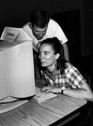 Photo of Darin helps Sherri at the computer