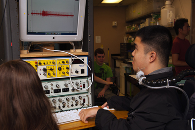 Image of a student using a computer to input data during a neurobiology lab.