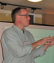 Bob Regan from Adobe giving a presentation.