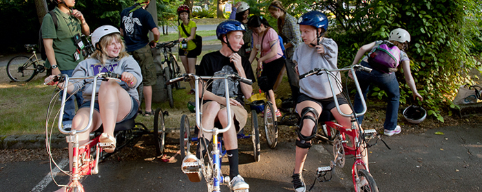 Image of participants riding accessible bicycles during Outdoors for All