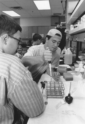 Picture of Michael and Todd at a lab table performing an experiment.