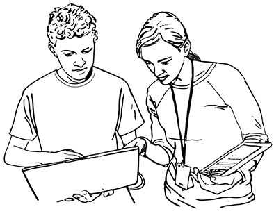 An instructor works with a student on a computer.