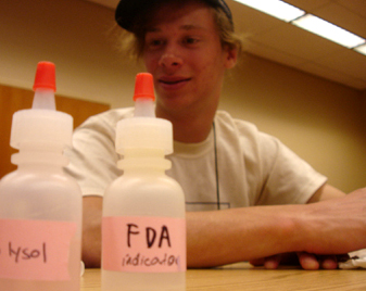 Photo of a student at a lab experiment